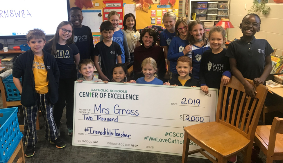 Group of students with giant check